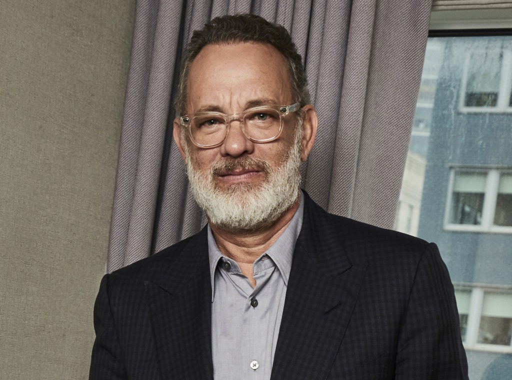 """FILE - This Nov. 17, 2019 photo shows Tom Hanks posing for a portrait in New York. Hank's latest film """"Greyhound,"""" premieres this week on Apple TV Plu..."""