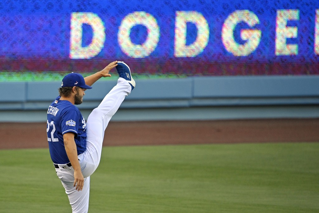 Los Angeles Dodgers starting pitcher Clayton Kershaw stretches during baseball training for the team Monday, July 6, 2020, in Los Angeles. (AP Photo/M...