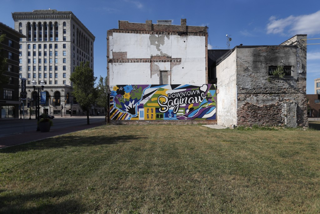 Buildings from different eras of the city's history surround an empty lot in downtown Saginaw, Mich., Monday, June 29, 2020. President Donald Trump wo...