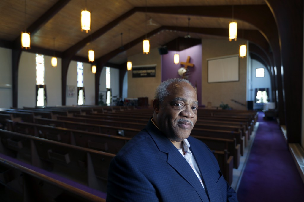 Pastor Hurley J. Coleman Jr., poses for a portrait Monday, June 29, 2020, inside the sanctuary of the World Outreach Campus Church in Saginaw, Mich. H...