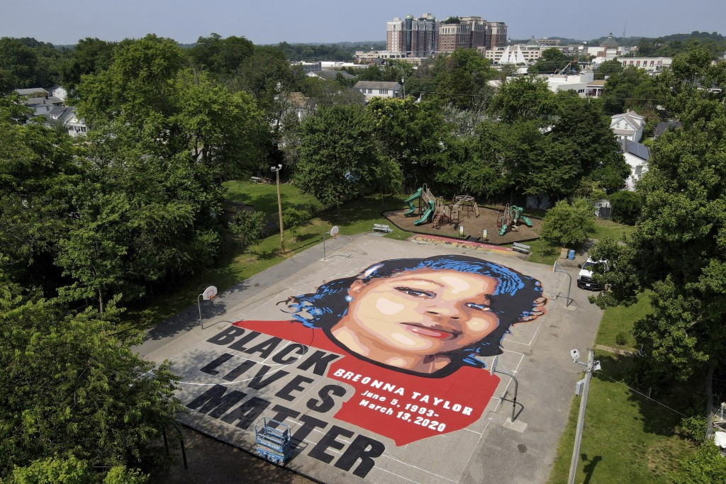 A ground mural depicting a portrait of Breonna Taylor is seen at Chambers Park, Monday, July 6, 2020, in Annapolis, Md. The mural honors Taylor, a 26-...