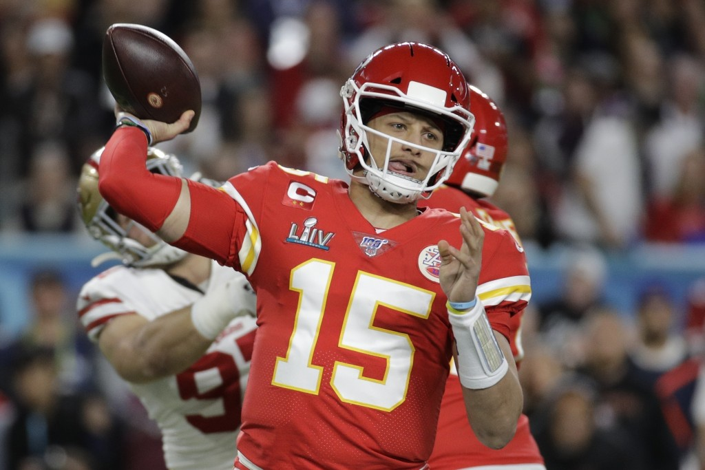 FILE - In this Feb. 2, 2020, file photo, Kansas City Chiefs quarterback Patrick Mahomes (15) passes against the San Francisco 49ers during the first h...