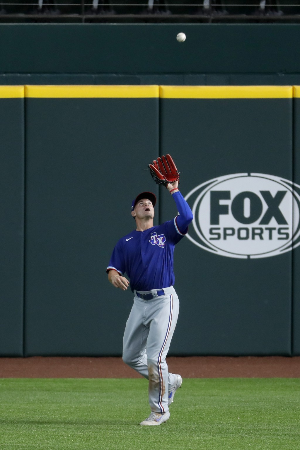 Texas Rangers outfielder Scott Heineman reaches up to catch a fly ball hit by Josh Jung during an intrasquad game at baseball practice in Arlington, T...