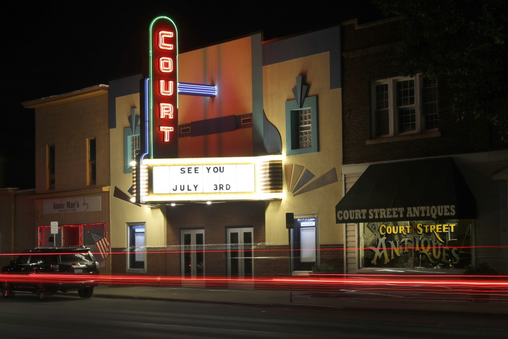 Traffic passes by the Court Street Theatre Monday, June 29, 2020, as the marque signals its reopening date in Saginaw, Mich. The unemployment rate aro...
