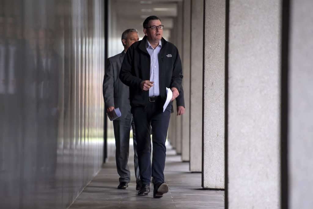 Victorian Premier Daniel Andrews walks to a press conference in Melbourne, Monday, July 6, 2020. As Australia is emerging from pandemic restrictions, ...
