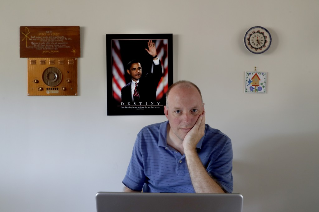 Dave Adams poses for a portrait Tuesday, June 30, 2020, at the kitchen table of his parents home in St. Charles, Mich. Adams, 47, left his job as an a...
