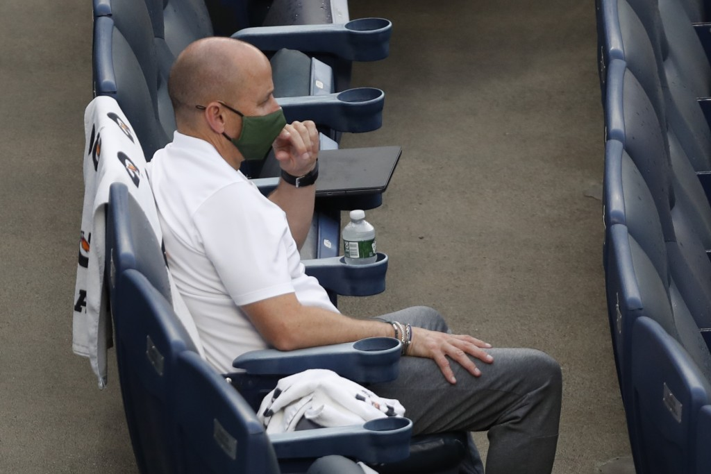 New York Yankees general manager Brian Cashman watches the baseball team's intrasquad game Monday, July 6, 2020, at Yankee Stadium in New York. (AP Ph...