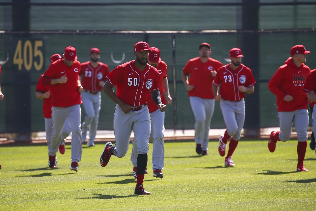 FILE - In this Feb. 17, 2020, file photo, Cincinnati Reds relief pitcher Amir Garrett leads other pitchers in sprints during spring training baseball ...
