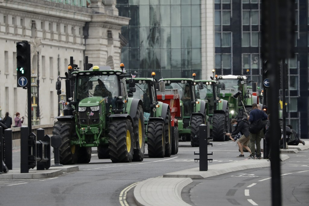 Farmers from the group Save British Farming drive tractors across Westminster Bridge, in London, in a protest against cheaply produced lower standard ...