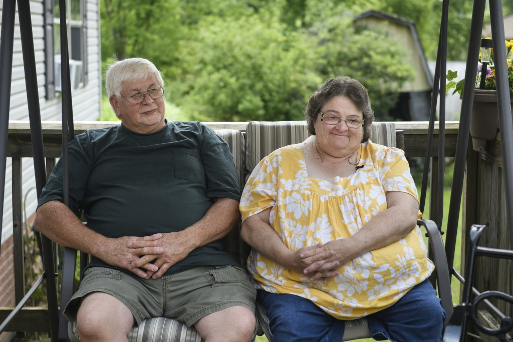 Doris Kelley, 57, sits with her husband, Tom Grimm, 62, on the front porch of their home on Monday, June 29, 2020 in Ruffs Dale, Pa. Kelley was one of...