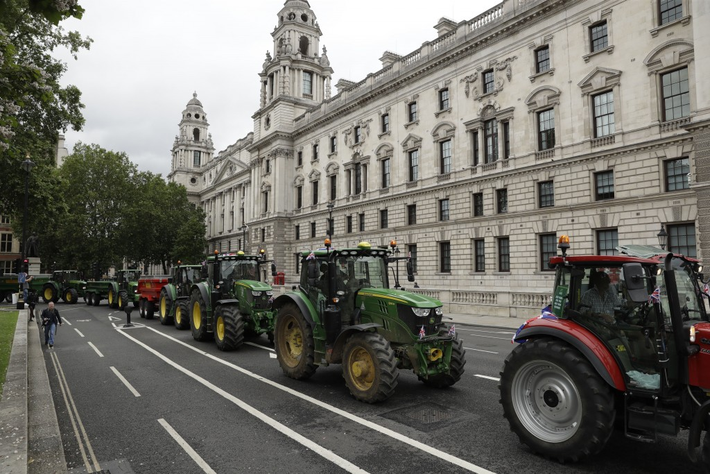 Farmers from the group Save British Farming drive tractors around Parliament Square, in London, in a protest against cheaply produced lower standard f...