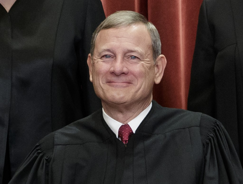 FILE - This Nov. 30, 2018, file photo shows Chief Justice of the United States, John Roberts, as he sits with fellow Supreme Court justices for a grou...