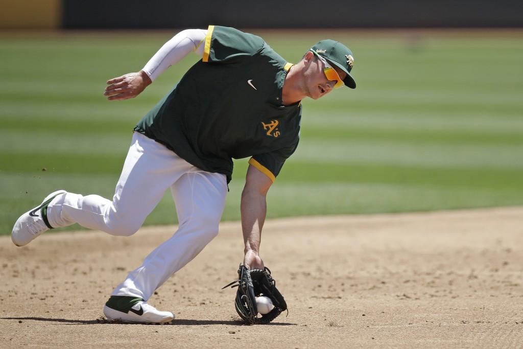 Oakland Athletics third baseman Matt Chapman fields a ball during baseball practice on Tuesday, July 7, 2020, in Oakland, Calif. (AP Photo/Ben Margot)