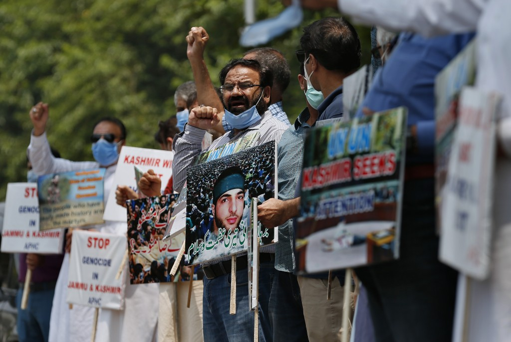 Supporters of All Parties Hurriyat Conference hold a demonstration to mark the 4th death anniversary of Kashmiri resistance leader Burhan Wani and to ...