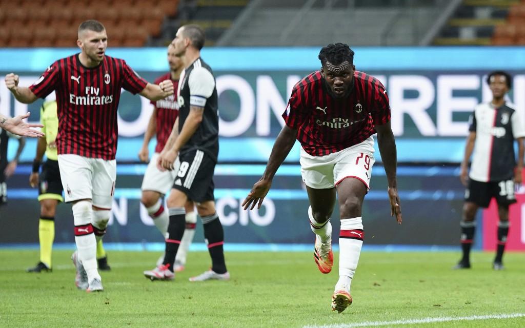 AC Milan's Franck Kessie celebrates after scoring his side's 2nd goal during the Serie A soccer match between AC Milan and Juventus at the Milan San S...