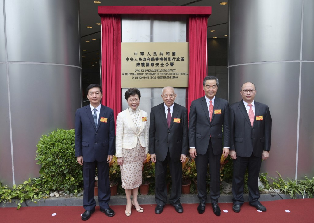 From left, Director of the Liaison Office and National Security Adviser to the Committee for Safeguarding National Security in Hong Kong Luo Huining, ...