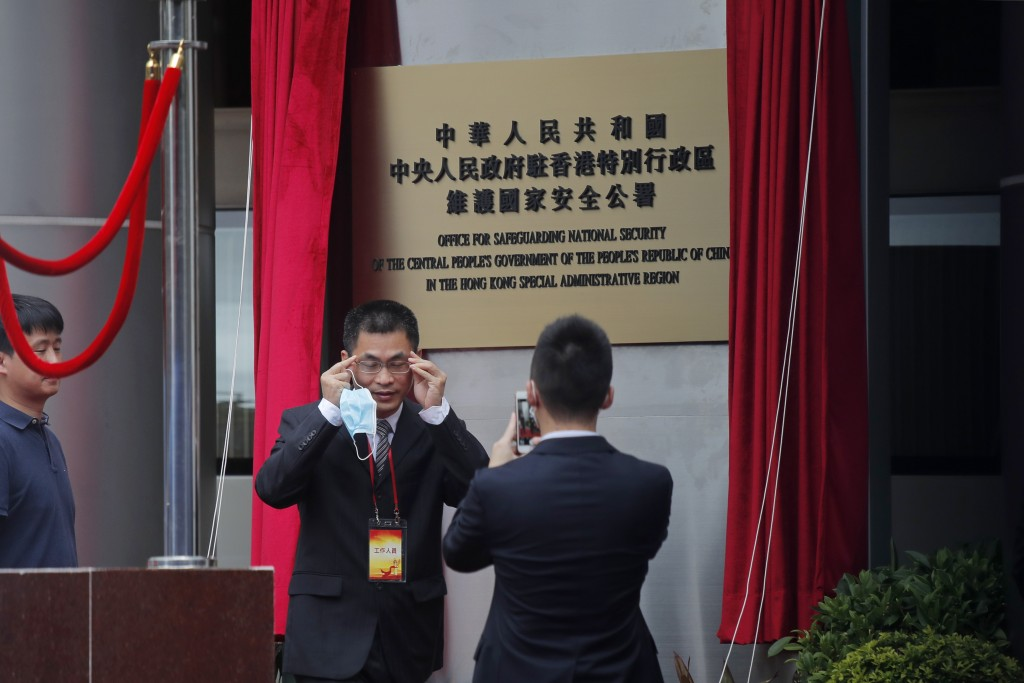 Mainland Chinese Communist Party officials and Hong Kong officials attend an opening ceremony for the China's new Office for Safeguarding National Sec...