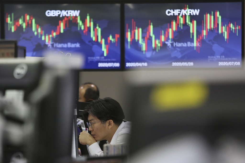A currency trader watches monitors at the foreign exchange dealing room of the KEB Hana Bank headquarters in Seoul, South Korea, Wednesday, July 8, 20...