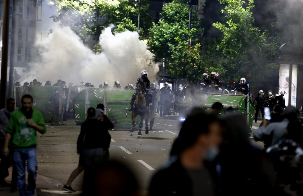 Sebian police officers disperse protesters in front of Serbian parliament building in Belgrade, Serbia, Wednesday, July 8, 2020. Thousands of people p...