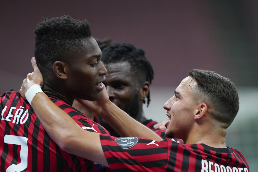 AC Milan's Rafael Leao, left, celebrates with his teammate Ismael Bennacer after scoring his side's 3rd goal during the Serie A soccer match between A...