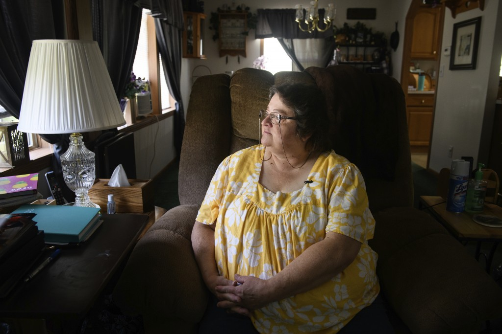 "Doris Kelley, 57, sits in her home on Monday, June 29, 2020 in Ruffs Dale, Pa. Kelley was one of the first patients in a UPMC trial for COVID-19. ""It ..."