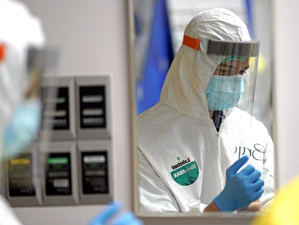 Medical student Bryan Delgado puts on PPE inside the Coronavirus Unit at United Memorial Medical Center, Monday, July 6, 2020, in Houston. Anyone seei...