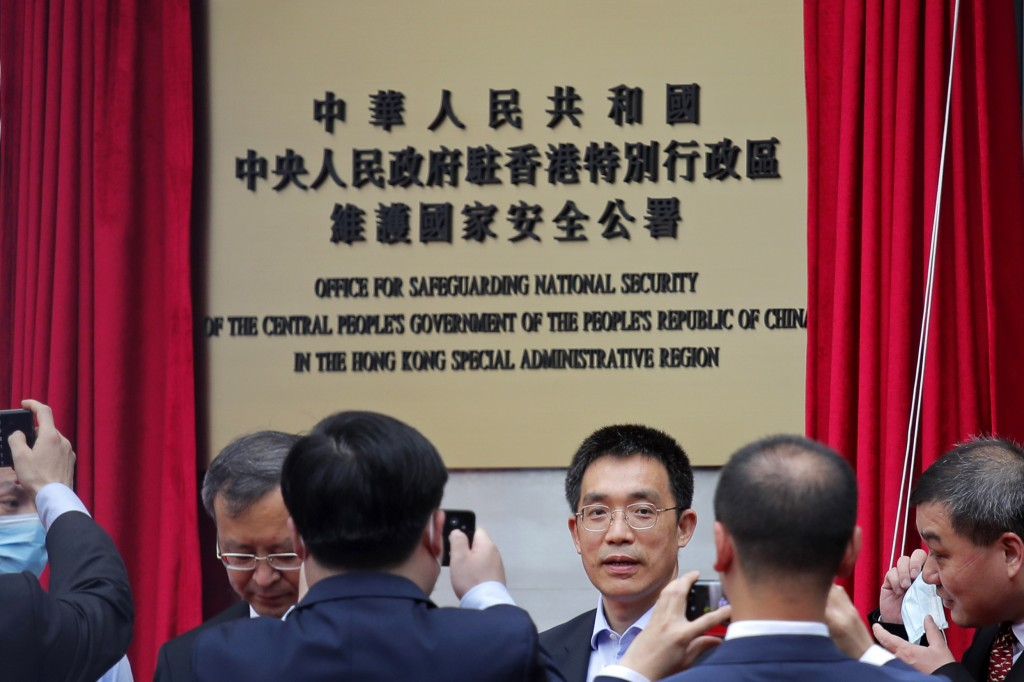 Mainland Chinese Communist Party officials and Hong Kong officials attend an opening ceremony for China's new Office for Safeguarding National Securit...