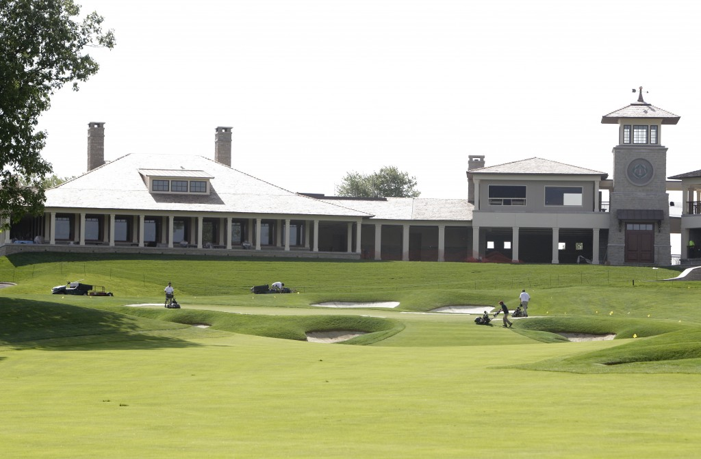 FILE - This Wednesday, May 22, 2013, file photo shows the clubhouse and 18th fairway at Muirfield Village Golf Club in Dublin, Ohio. The challenge for...