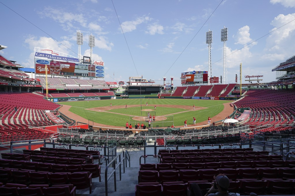 Cincinnati Reds players take the field for an intra-squad game during team baseball practice at Great American Ballpark in Cincinnati, Sunday, July 5,...