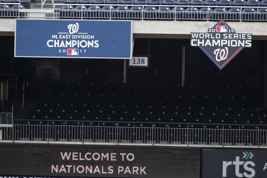 """A """"2019 World Series Champions,"""" sign is posted during a baseball training camp workout at Nationals Park, Wednesday, July 8, 2020, in Washington. (AP..."""