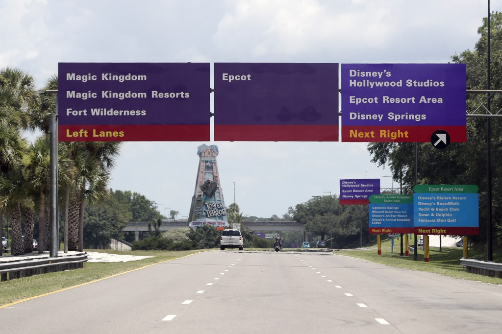 Signs direct motorists to the various theme parks at Walt Disney World, Thursday, July 2, 2020, in Lake Buena Vista, Fla. Magic Kingdom and Animal Kin...