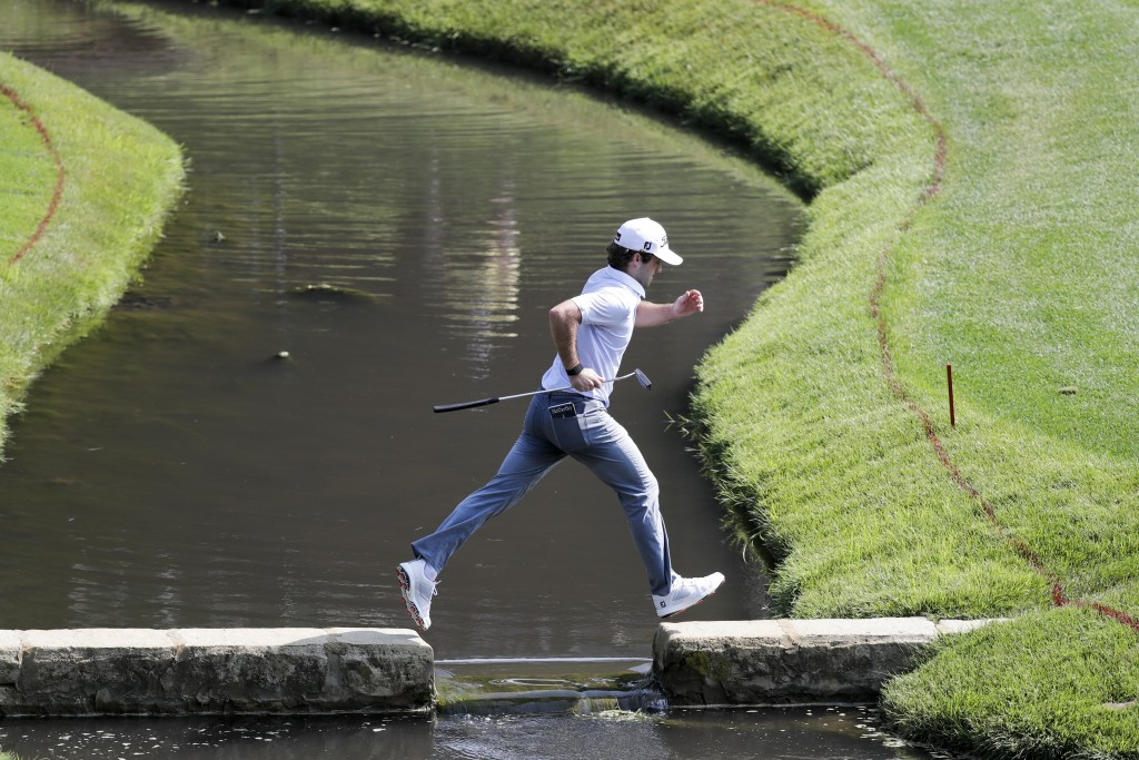 Denny McCarthy jumps across a bridge on the 14th hole during opening round of the Workday Charity Open golf tournament, Thursday, July 9, 2020, in Dub...