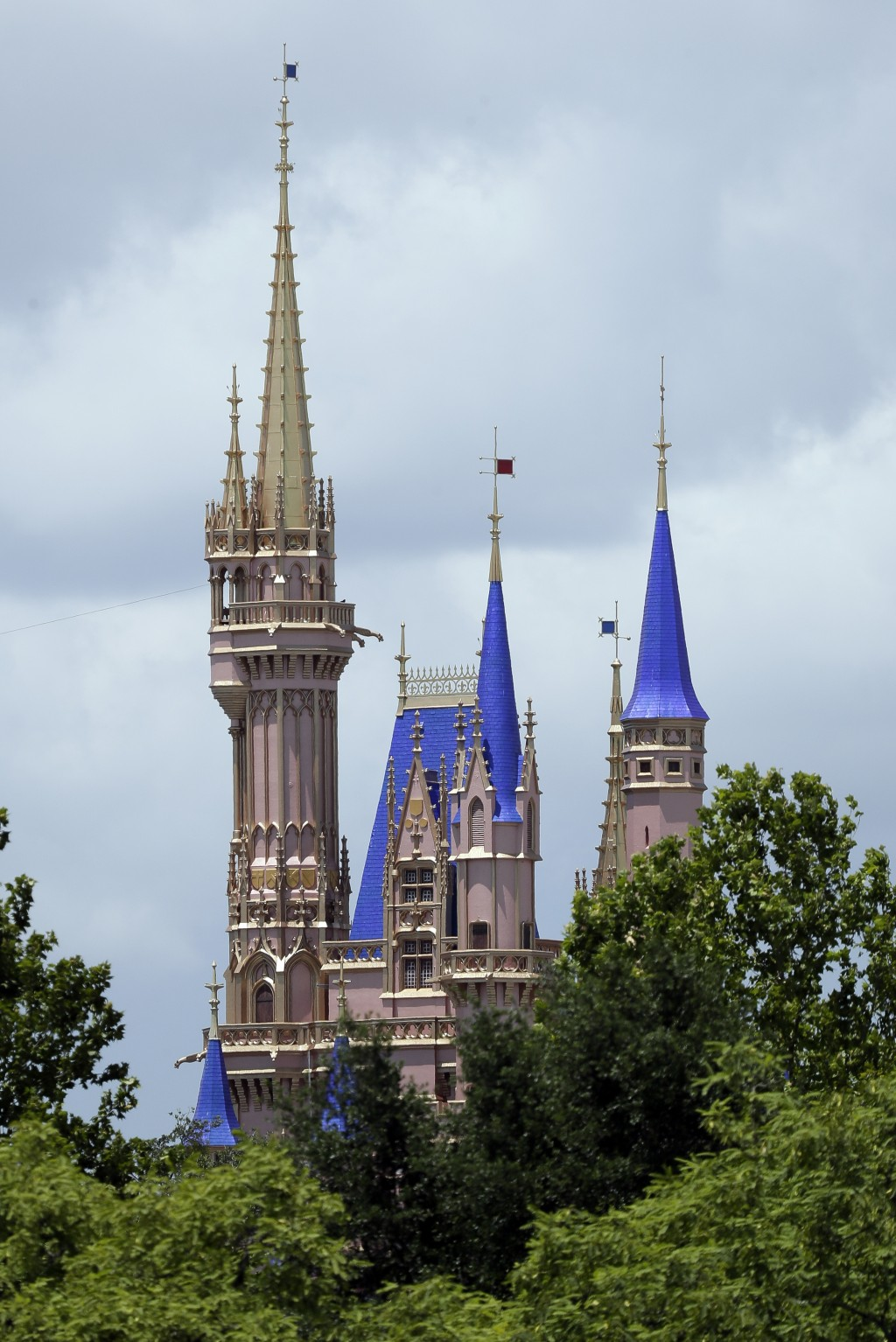 This photo shows the top of the newly painted Cinderella Castle in the Magic Kingdom from World Drive at Walt Disney World on Thursday, July 2, 2020, ...