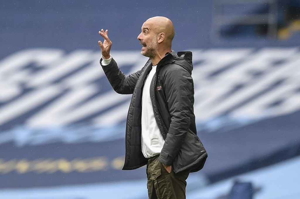 Manchester City's head coach Pep Guardiola gestures during the English Premier League soccer match between Manchester City and Newcastle at the Ethiad...