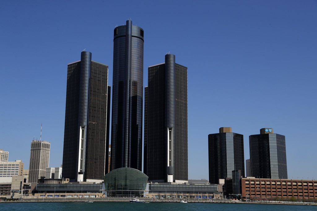 This May 12, 2020, photo shows a general view of the Renaissance Center, headquarters for General Motors, along the Detroit skyline from the Detroit R...