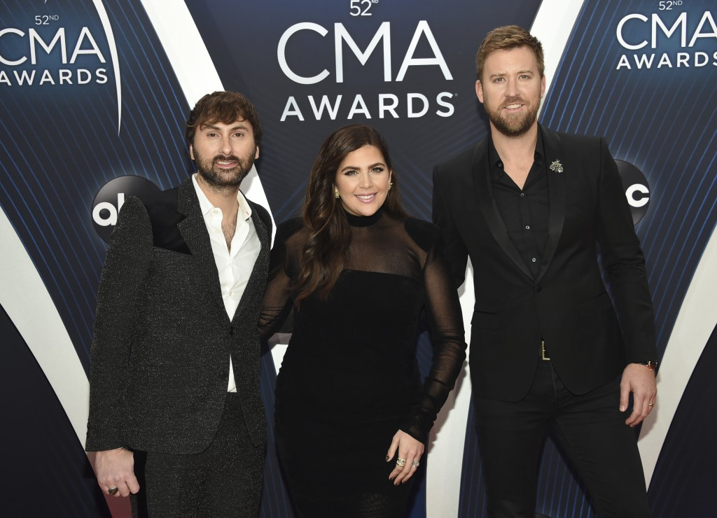 FILE - In this Nov. 14, 2018 file photo, Dave Haywood, from left, Hillary Scott and Charles Kelley, of Lady A, formerly Lady Antebellum, arrive at the...