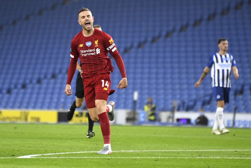 Liverpool's Jordan Henderson celebrates after scoring his team's second goal during the English Premier League soccer match between Brighton and Liver...