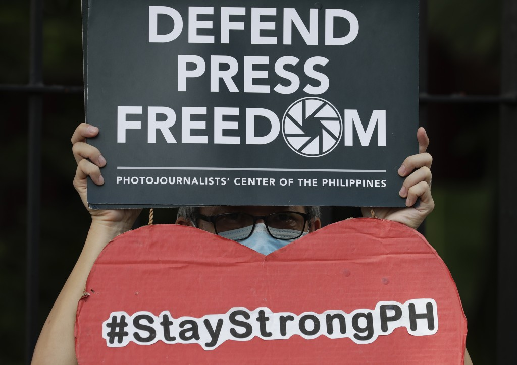 An employee of the country's largest TV network ABS-CBN, holds a slogan during a rally outside the House of Representatives in Manila, Philippines, Th...