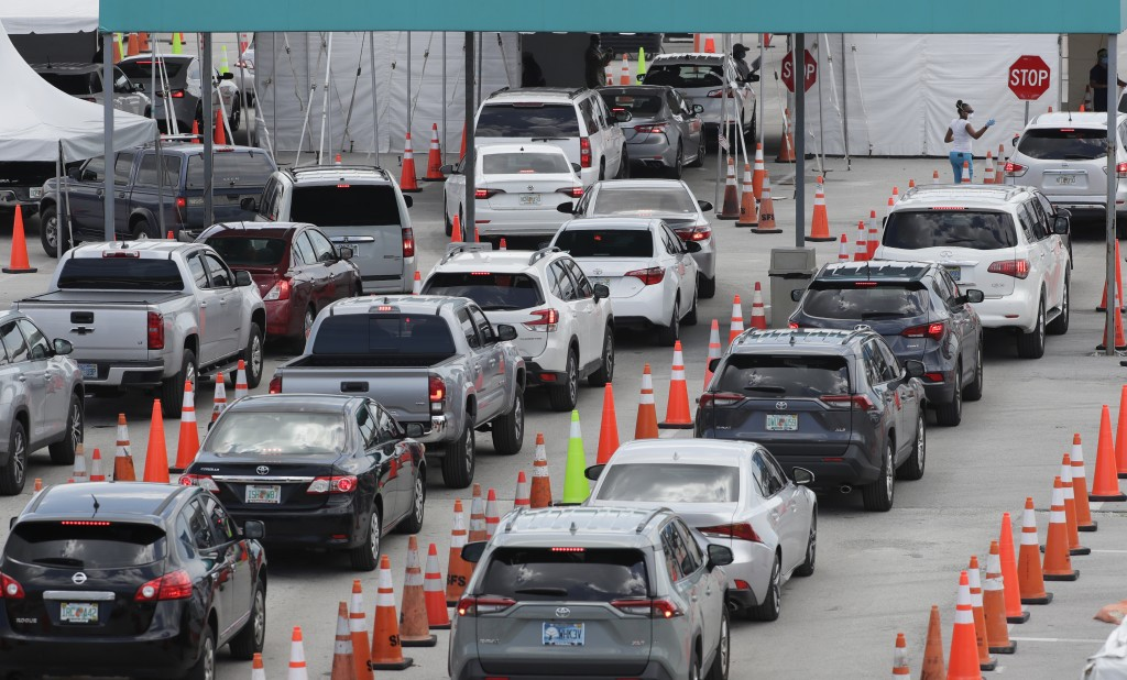 Vehicles wait in line at a drive-thru COVID-19 testing site outside Hard Rock Stadium, Wednesday, July 8, 2020, in Miami Gardens, Fla. Florida is one ...