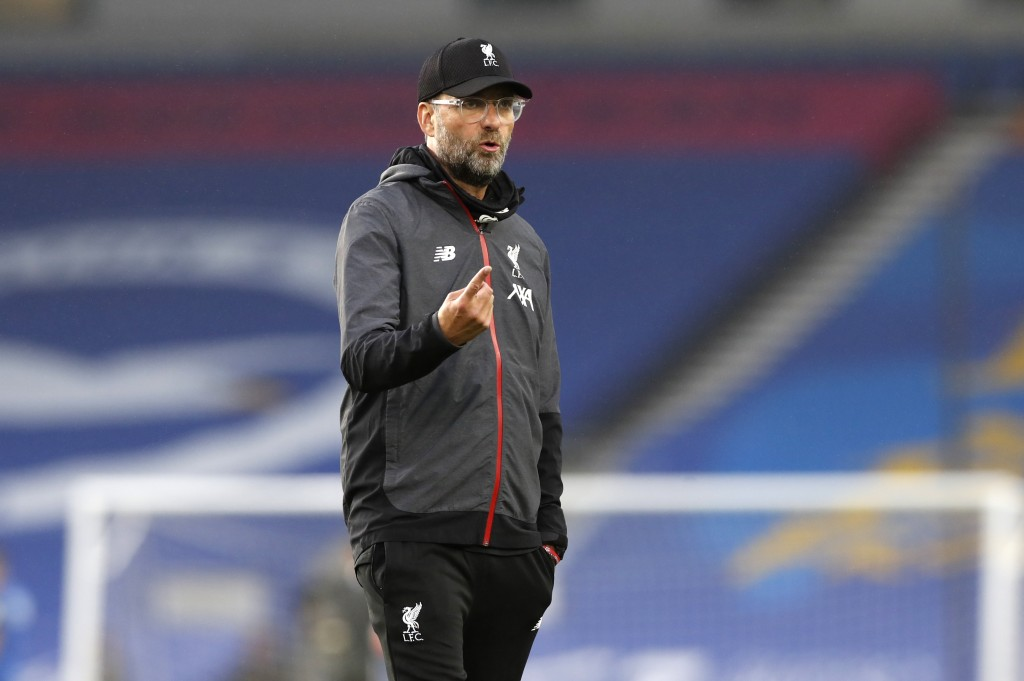 Liverpool's manager Jurgen Klopp gestures as he watches his players warm up ahead of the English Premier League soccer match between Brighton and Live...