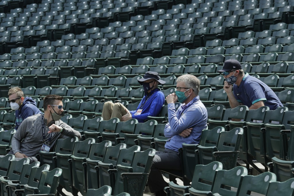 Seattle Mariners general manager Jerry Dipoto, second from left, manager Scott Servais, right, and team president and CEO Kevin Mather, second from ri...