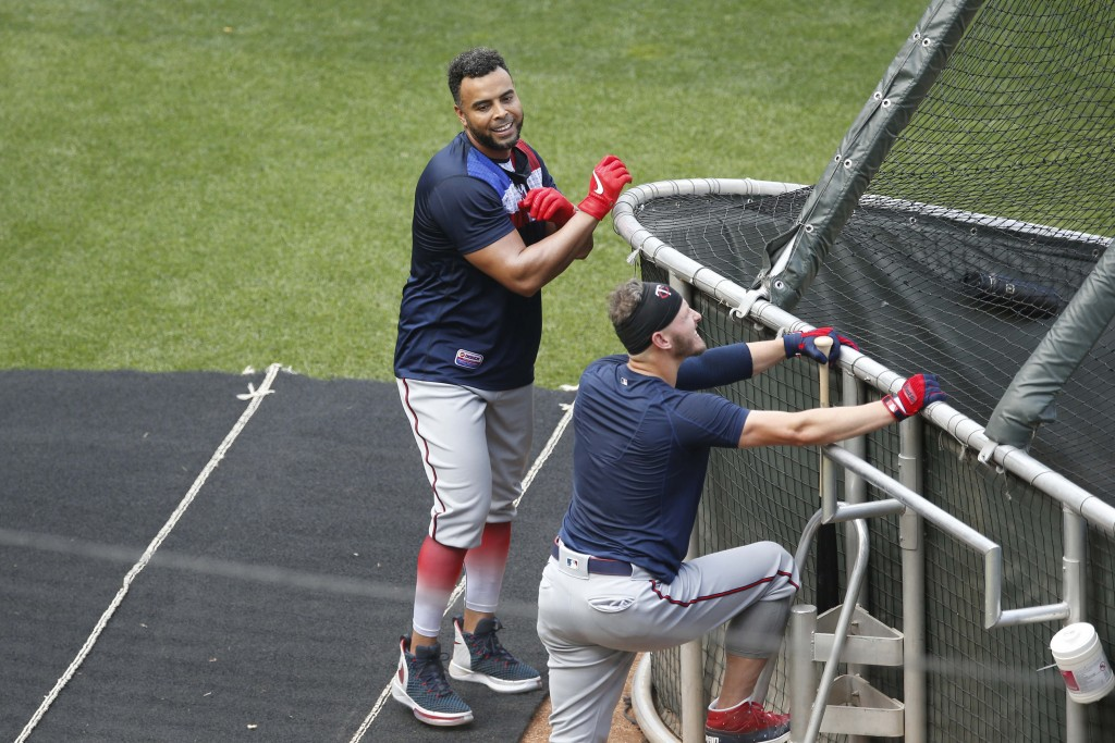 Minnesota Twins' Nelson Cruz, left, visits with Josh Donaldson during batting practice in the baseball summer camp Wednesday, July 8, 2020 in Minneapo...