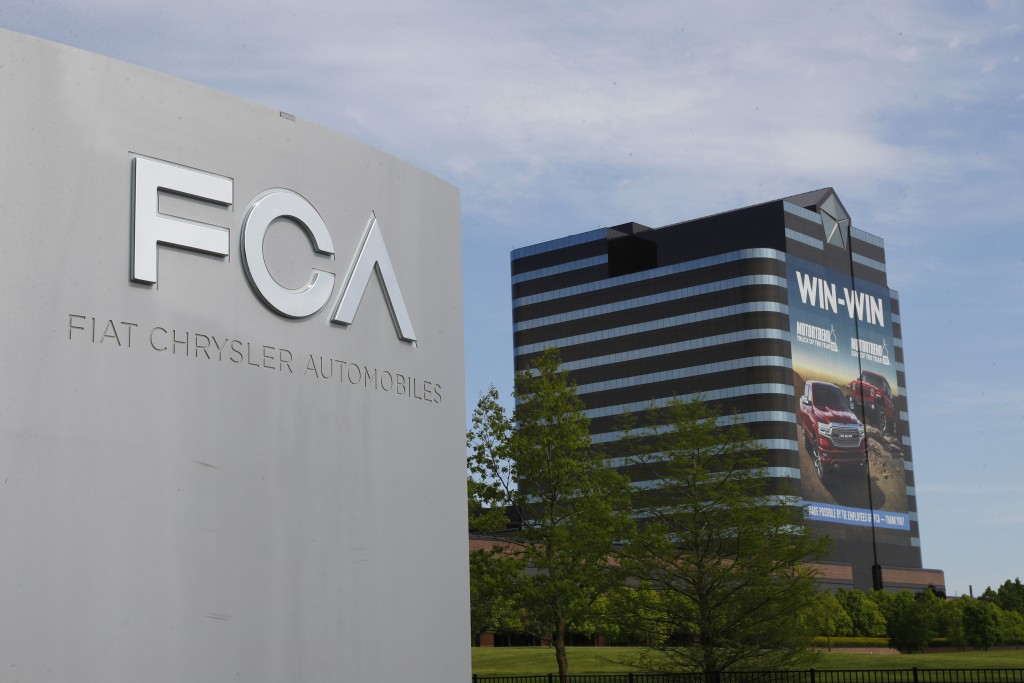 FILE - This May 27, 2019, file photo shows the Fiat Chrysler Automobiles world headquarters in Auburn Hills, Mich. A federal judge in Detroit dismisse...