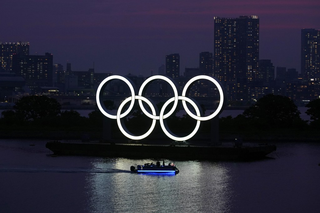 FILE - In this June 3, 2020, photo, the Olympic rings float in the water at sunset in the Odaiba section in Tokyo. Masa Takaya, the spokesman for the ...