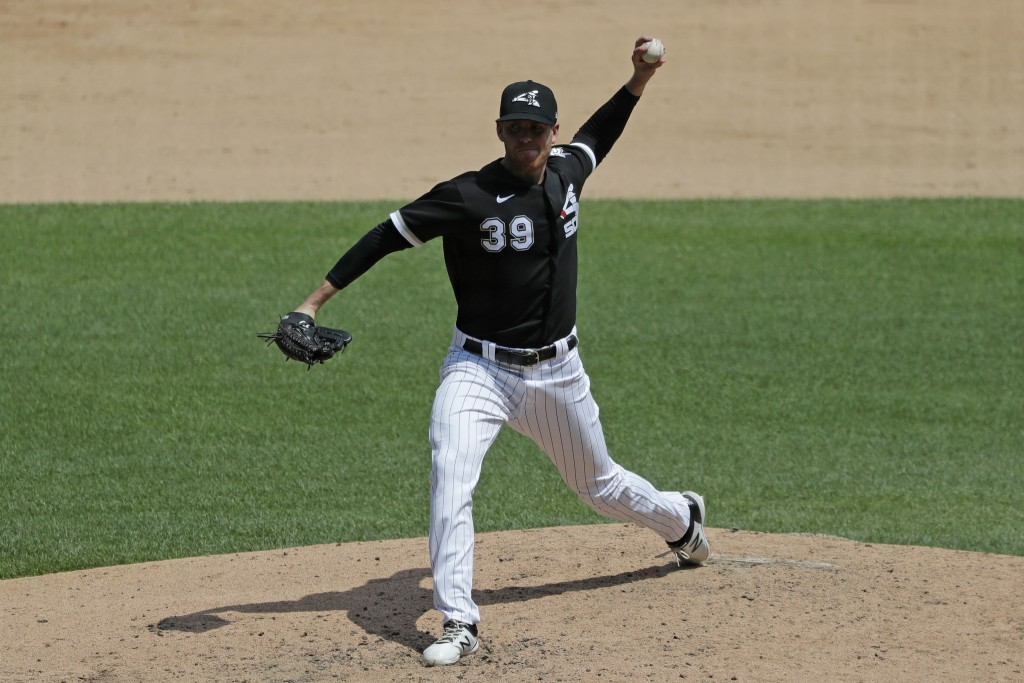 Chicago White Sox pitcher Aaron Bummer throws during baseball practice at Guaranteed Rate Field in Chicago, Thursday, July 9, 2020. (AP Photo/Nam Y. H...