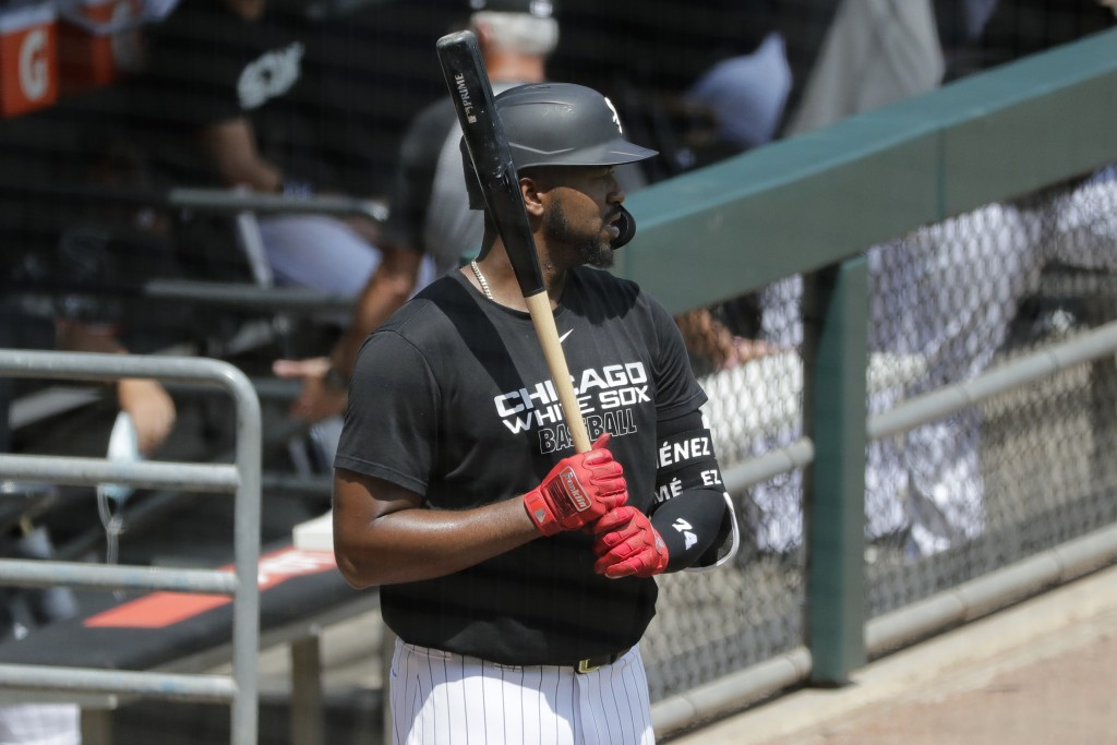 Chicago White Sox's Eloy Jimenez looks towards the field during baseball practice at Guaranteed Rate Field in Chicago, Thursday, July 9, 2020. (AP Pho...