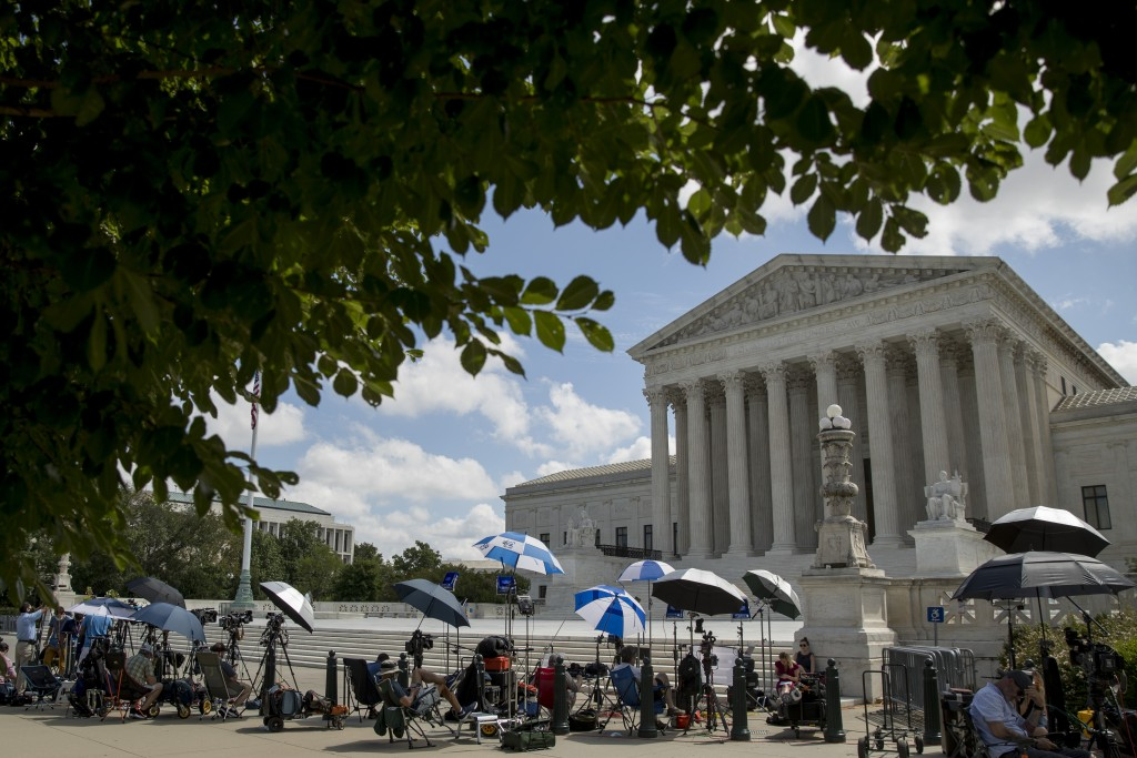 Members of the media set up outside the Supreme Court, Thursday, July 9, 2020, in Washington. The Supreme Court ruled Thursday that the Manhattan dist...
