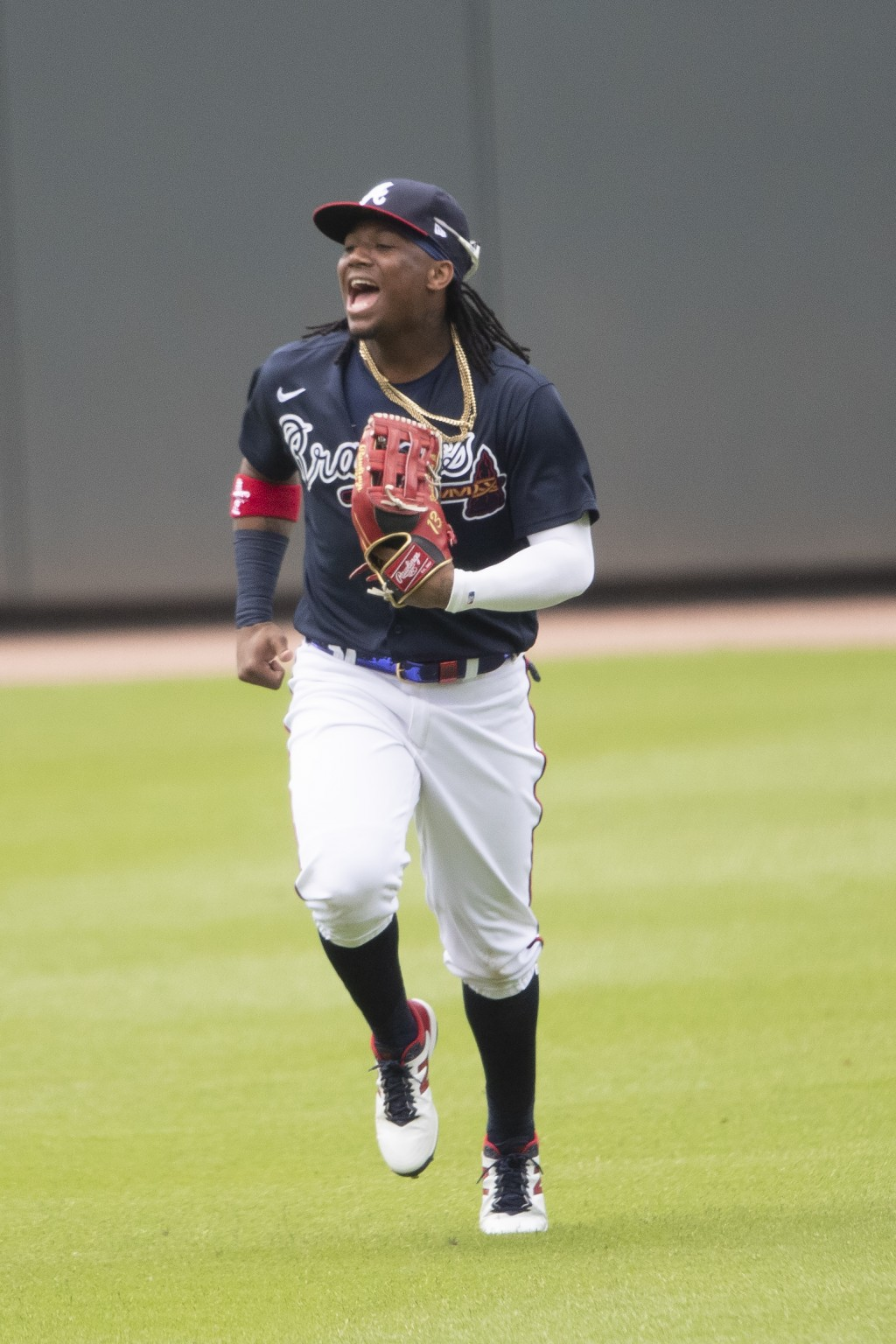 Atlanta Braves center fielder Ronald Acuna Jr. (13) jokes with teammates as he runs in from the outfield during a practice baseball game, Thursday, Ju...