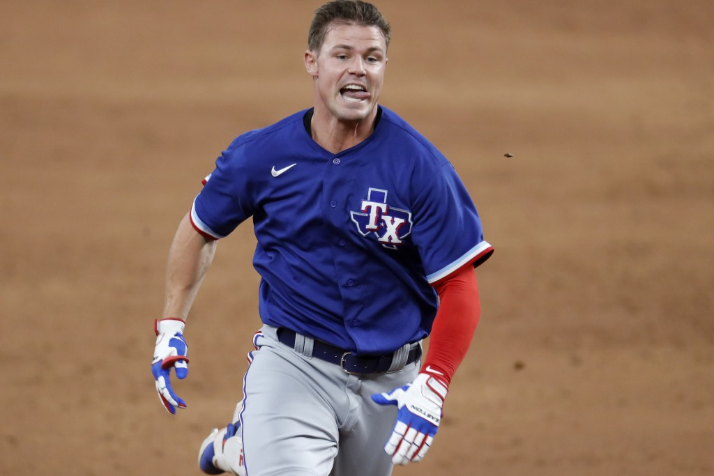 Texas Rangers' Scott Heineman sprints to third with a triple during the baseball team's intrasquad game in Arlington, Texas, Thursday, July 9, 2020. (...