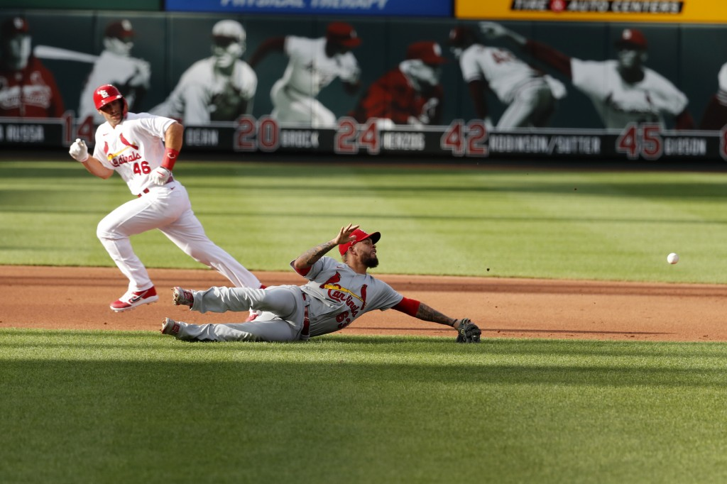 St. Louis Cardinals' Paul Goldschmidt (46) watches as a ball hit by Paul DeJong gets past infielder Edmundo Sosa for a two-run single during an intras...